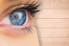 Составное изображение конца вверх женского голубого глаза Стоковая Фотография