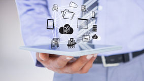 Составное изображение конца вверх по взгляду бизнесмена используя планшет Стоковое фото RF