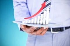 Составное изображение конца вверх по взгляду бизнесмена используя планшет Стоковая Фотография