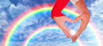 Составное изображение конца вверх рук формируя сердце Стоковое Изображение RF