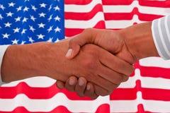 Составное изображение корпоративных людей делая рукопожатие Стоковое фото RF