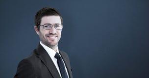 Составное изображение красивого бизнесмена усмехаясь на камере Стоковое Изображение