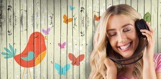 Составное изображение красивой женщины наслаждаясь слушать ее музыка Стоковая Фотография RF