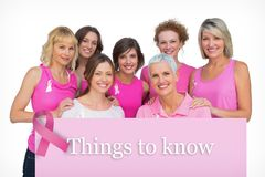 Составное изображение красивых женщин представляя и нося пинк для рака молочной железы Стоковое Изображение RF