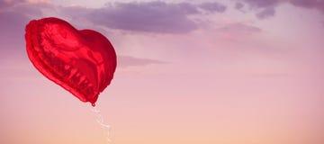 Составное изображение красного воздушного шара сердца Стоковые Фотографии RF