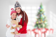 Составное изображение матери и дочери с игрушечным Стоковая Фотография RF
