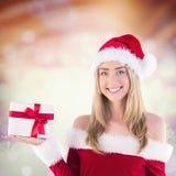 Составное изображение милой девушки santa держа подарок Стоковое Изображение