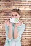 Составное изображение милой женщины показывая 100 примечаний евро Стоковое Фото