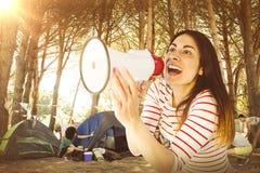 Составное изображение молодой женщины крича с мегафоном Стоковое Изображение RF