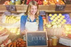 Составное изображение молодой женщины при еда стоя на таблице Стоковое Изображение RF