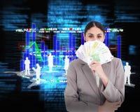 Составное изображение молодой коммерсантки пряча ее сторону за бумажными деньгами Стоковые Изображения