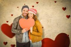 Составное изображение молодых пар держа сердце формирует бумагу Стоковое Изображение RF