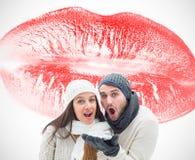 Составное изображение молодых пар зимы Стоковое фото RF
