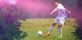 Составное изображение мужского футболиста играя футбол Стоковые Фото
