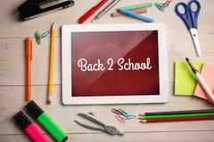 Составное изображение назад к тексту школы против белой предпосылки Стоковое фото RF