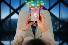 Составное изображение надземного взгляда коммерсантки используя мобильный телефон Стоковое Фото