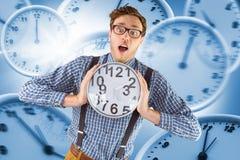 Составное изображение отвратительного бизнесмена держа часы Стоковое Изображение