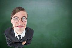Составное изображение отвратительного бизнесмена усмехаясь на камере Стоковые Изображения RF
