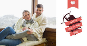Составное изображение пар в одежде зимы сидя против окна кабины Стоковые Фотографии RF
