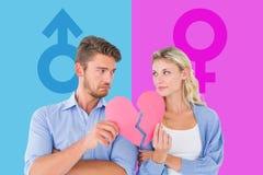 Составное изображение пар держа 2 половины разбитого сердца Стоковое фото RF