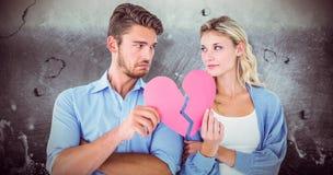 Составное изображение пар держа 2 половины разбитого сердца Стоковое Изображение RF