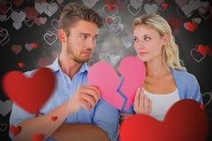 Составное изображение пар держа 2 половины разбитого сердца Стоковые Фотографии RF
