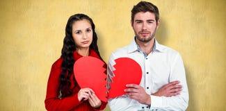 Составное изображение пар держа половины сердца Стоковая Фотография