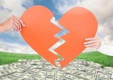 Составное изображение пар держа разбитый сердце Стоковая Фотография RF