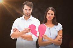 Составное изображение пар осадки держа 2 половины разбитого сердца Стоковые Фотографии RF