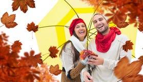 Составное изображение пар осени держа зонтик Стоковая Фотография RF