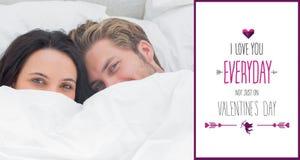 Составное изображение пар пряча под одеялом Стоковая Фотография