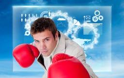 Составное изображение перчаток бокса уверенно бизнесмена нося Стоковая Фотография RF