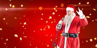Составное изображение песен рождества петь Санта Клауса Стоковые Изображения RF