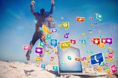 Составное изображение победоносного бизнесмена скача выходящ его компьтер-книжка Стоковая Фотография RF