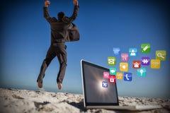 Составное изображение победоносного бизнесмена скача выходящ его компьтер-книжка 3d Стоковые Изображения