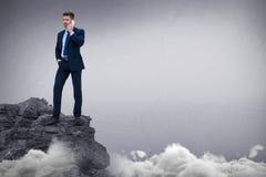 Составное изображение портрета бизнесмена стоя говоря на умном телефоне Стоковые Фотографии RF