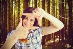 Составное изображение портрета женщины смотря через руки Стоковое Изображение RF