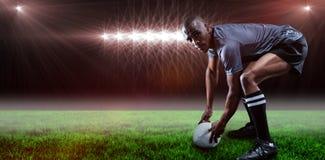 Составное изображение портрета игрока рэгби держа шарик и 3d Стоковые Изображения RF