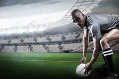 Составное изображение портрета игрока рэгби держа шарик Стоковое фото RF