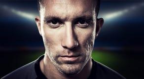 Составное изображение портрета конца-вверх серьезного игрока рэгби Стоковые Фото