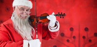 Составное изображение портрета Санта Клауса играя скрипку Стоковые Изображения RF