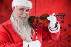 Составное изображение портрета Санта Клауса играя скрипку Стоковое Изображение RF