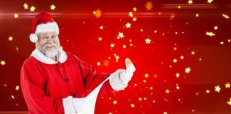Составное изображение портрета Санта Клауса усмехаясь и держа перечень Стоковая Фотография RF