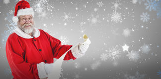 Составное изображение портрета Санта Клауса усмехаясь и держа перечень Стоковое Фото