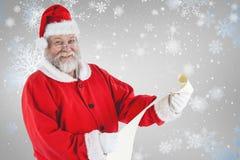 Составное изображение портрета Санта Клауса усмехаясь и держа перечень Стоковое Изображение