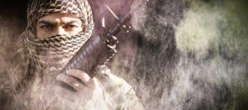 Составное изображение портрета солдата держа винтовку Стоковые Фото