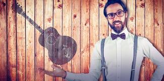 Составное изображение портрета человека показывать с рукой на бедре Стоковое фото RF