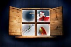 Составное изображение поставки santa представляет к деревне Стоковые Фото