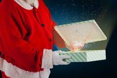 Составное изображение подарочной коробки отверстия Санта Клауса Стоковое Фото