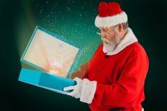 Составное изображение подарочной коробки отверстия Санта Клауса Стоковые Изображения